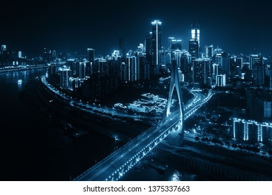 Aerial view of Bridge and city urban architecture at night in Chongqing, China.