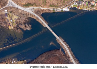 Aerial view of a bridge crossing a lake from a drone