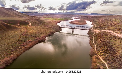 aerial view of a bridge going over a river in idaho