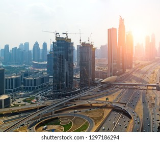 Aerial view bridge of highway traffic interchange of a city Dubai skyline. Transport traffic road with vehicle movement aerial view. Top view uae. Background scenic road.