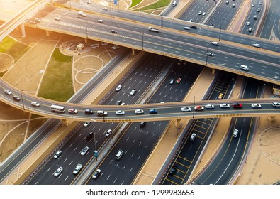 Aerial view bridge of highway traffic interchange of a sunrise Cityscape. Transport junction traffic road with vehicle movement aerial view. Background scenic road.