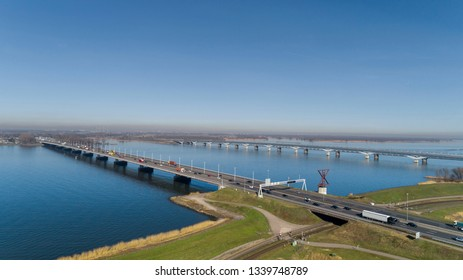 Aerial view of bridge MOERDIJK BRUGGEN over the river HOLLANDSCH DIEP in Holland. Those bridges connect the provinces of Zuid-Holland and Noord-Brabant. It is a railroad bridge and a traffic bridge
