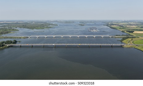 Aerial view of bridge MOERDIJK BRUGGEN over the river HOLLANDSCH DIEP in Holland. Those bridges connect the provinces of Zuid-Holland and Noord-Brabant. It is a railroad bridge and a traffic bridge.