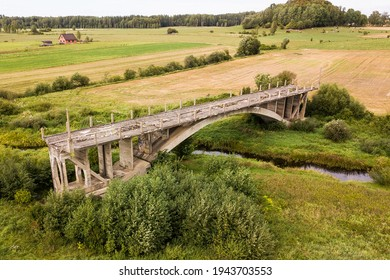 Aerial view of bridge to nowhere. An old bridge in Grenci, Latvia never getting ready.