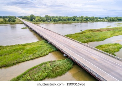 aerial view of a bridge over shallow and braided Platte River near Kearney, Nebraska in summer scenery