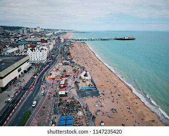 Aerial view of Brighton beach and Brighton Pier in Brighton, England, United Kingdom.