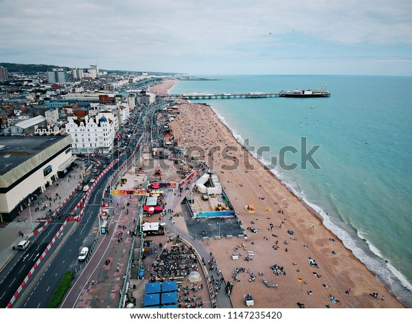 Aerial view of Brighton beach and Brighton Pier in Brighton, England, United Kingdom.