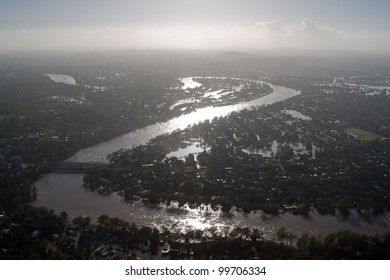 Aerial view Brisbane River Flood January 2011 Silhouette. Dramatic highlights show river meandering through the city during its darkest hour.