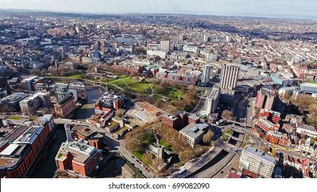 Aerial View of Bristol City Center in England, UK feat. St Peter's Church, Castle Park, River Avon and Streets along the Local Traffic and Cars