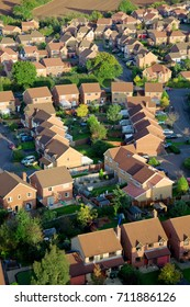Aerial view of British red brick houses in a modern estate.