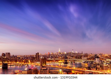 Aerial view of Brooklyn and Manhattan Bridge over East River, and midtown Manhattan Skyline from Brooklyn Heights