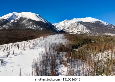 Aerial view of Buffalo Mountain and Red Peak along the Gore Range near Silverthorne in Summit County, Colorado.