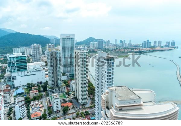 Aerial view of building facing to ocean.