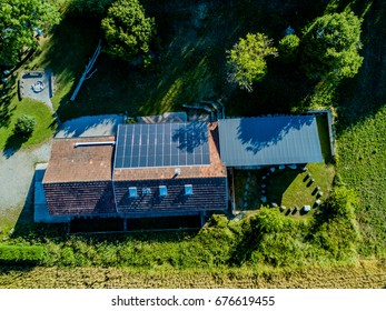 Aerial view of building rooftop and solar cells