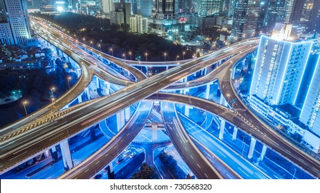 aerial view of buildings and highway interchange at night in Shanghai city
