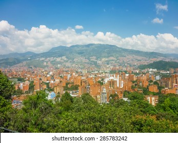 Aerial view of buildings and mountains from Nutibara hill in Medellin, one of the most important cities of Colombia, in South America