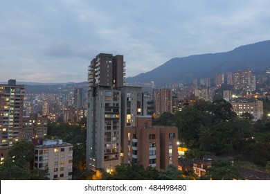 Aerial view of buildings and mountains from Nutibara hill in Medellin at night, one of the most important cities of Colombia, in South America