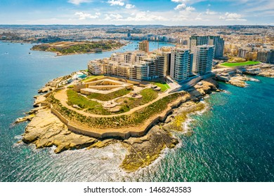 Aerial view of buildings in Sliema city. Malta. Mediterranean sea. Summer, blue sky and clouds on background