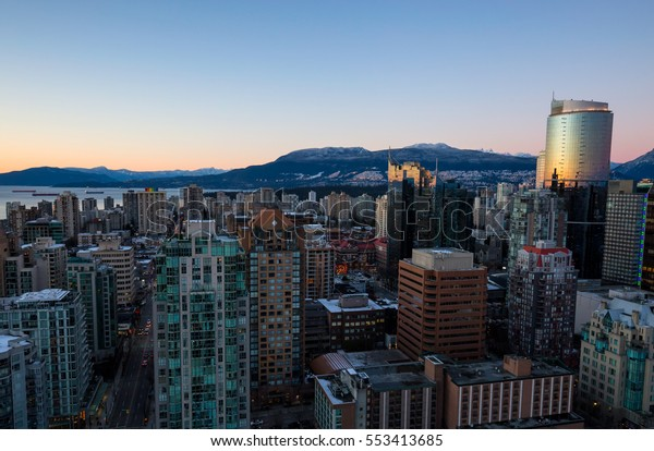 Aerial view of the buildings in Vancouver Downtown, BC, Canada. Taken during a winter sunset.