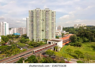 aerial view of Bukit Batok township, with train approaching the MRT station, a matured residential town located the West Region of Singapore.