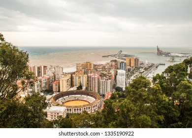 Aerial view of the bullring and the port of Malaga, Spain.
