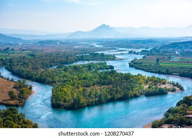 Aerial view of the Buna River after the confluence with the Drin River from Rozafa Castle, Shkoder, Albania. Meandres and mountain. Beautiful Landscape