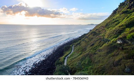 Aerial view of Burleigh Heads lower walking track and shoreline and sunrise.