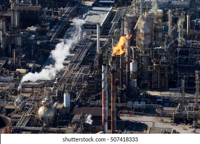 Aerial view of a burning oil & gas refinery flare stack