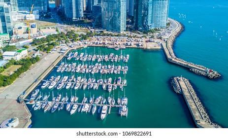 Aerial view busan marina with yachts, Marina city skyscrapers with reflection, Haeundae District, Busan, South Korea.