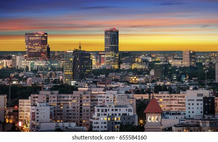Aerial view of the business district in Bucharest, Romania at sunset.