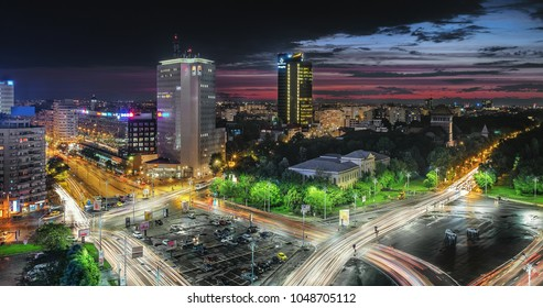 Aerial view of the business district in the Victoria Square. Night lights after a storm, sunset in Bucharest, Romania.