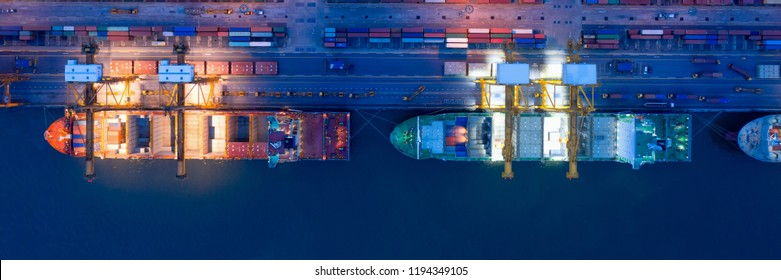 Aerial view of business port with shore crane loading container in container ship in import/export and business logistics with crane and shipping port cargo.International transportation port concept.