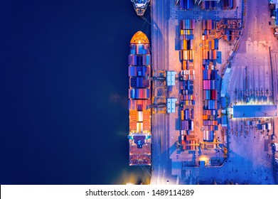 Aerial view of business port with shore crane loading container in container ship in import/export and business logistics with crane and shipping port cargo.International transportation concept.