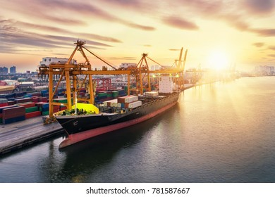 Aerial view of business port with Shore crane loading containers in Container ship in import export and business logistics with crane and Shipping cargo. International transportation and Business