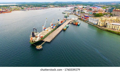 Aerial view of busy port with container ships in Labuan Pearl of Borneo,Malaysia. Container ship in export and import business logistics.