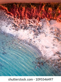 An aerial view of Cable Beach and Gantheaume Point in Broome, Western Australia. Taken during the sunset.
