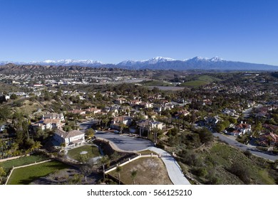 Aerial View of California Neighborhood with Snow Covered Mt. Baldy in Background