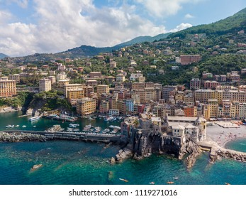 Aerial View of Camogli town in Liguria, Italy. Scenic Mediterranean riviera coast. Historical Old Town Camogli with colorful houses and sand beach at beautiful coast of Italy.
