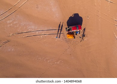 Aerial view Campsite at Atacama Desert an amazing road trip along the driest desert in the world with a 4x4 truck and a tent mounted on the campsite and still the views of the car track. An awe scenic