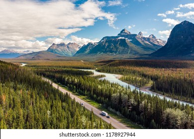 Aerial view of the Canadian Rockies showing the famous Icefields Parkway road between Jasper and Banff National Parks in Alberta, Canada.