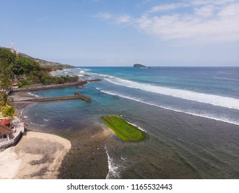 An aerial view of the Candidasa beach and coastline in Bali in Indonesia