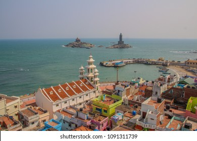 Aerial view of Cape Comorin. kanyakumari  (INDIA). View of Vivekananda Rock Memorial and Thiruvalluvar Statue. Overlooking St Arockianathar Church and Fisherman's village.