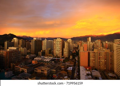 Aerial view of capital city Santiago de Chile and Andes mountains in sunset, Chile, South America.