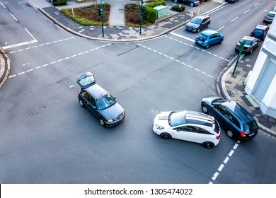 Aerial view of car accident on road crossing.