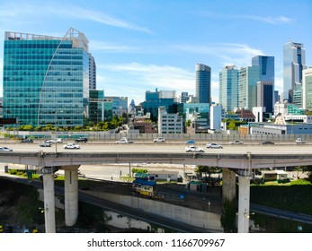 Aerial view of car driving on the bridge highway in Seoul, South of Korea. Side view of highway with cars going in both side. Busy traffic road next to city building, Seoul, South Korea, 08/20/2018