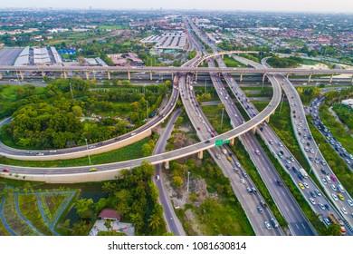 Aerial view car movement on traffic junction road with green tree park, Transport concept