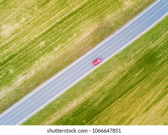 Aerial view of car moving on the road. Road traffic concept background.