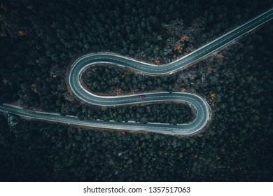 Aerial view of a car on a winding road in rural Spain