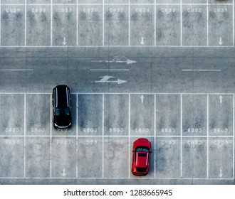 Aerial view of car park with many empty parking lots.