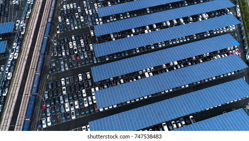 aerial view of a car park with solar panels